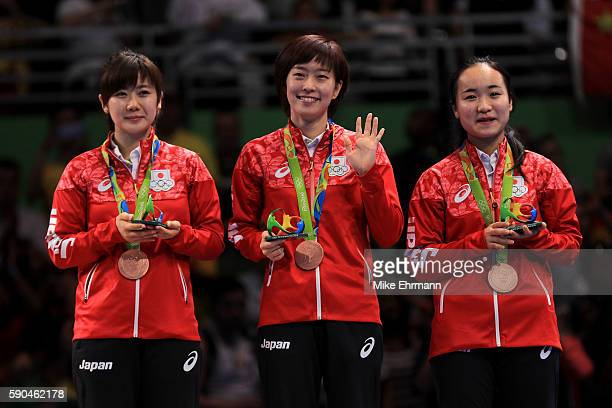 Bronze medalists Mima Ito Kasumi Ishikawa and Ai Fukuhara of Japan pose on the podium during the medal ceremony for the Women's Team Match between...