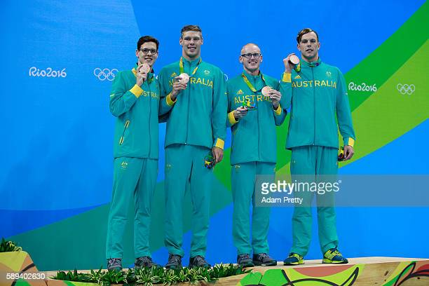 Bronze medalists Mitchell Larkin Jake Packard David Morgan and Kyle Chalmers of Australia pose on the podium during the medal ceremony for the Men's...