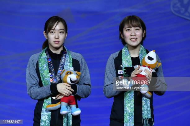 Bronze medalists Miu Hirano and Kasumi Ishikawa of Japan celebrate on the podium during Women's Doubles awarding ceremony on day eight of the...