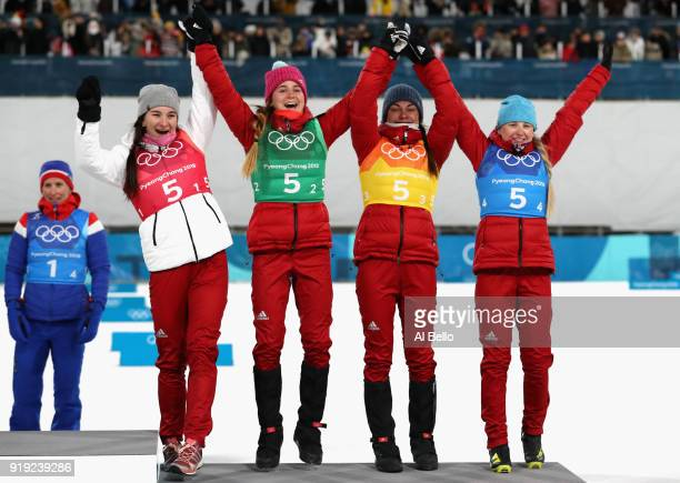 Bronze medalists Natalia Nepryaeva Yulia Belorukova Anastasia Sedova and Anna Nechaevskaya of Olympic Athlete from Russia celebrate on the podum...