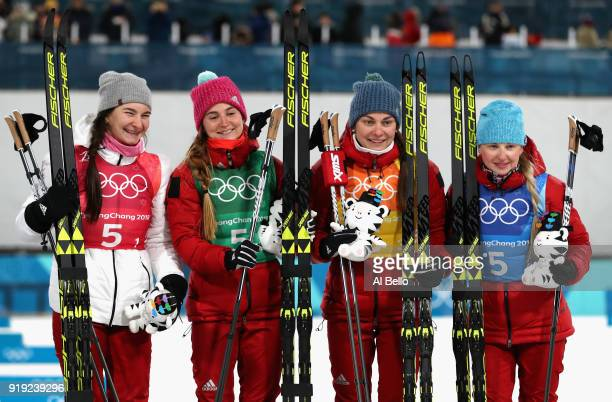 Bronze medalists Natalia Nepryaeva Yulia Belorukova Anastasia Sedova and Anna Nechaevskaya of Olympic Athlete from Russia celebrate on the podum...
