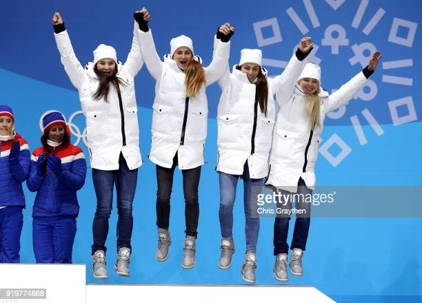 Bronze medalists Natalia Nepryaeva Yulia Belorukova Anastasia Sedova and Anna Nechaevskaya of Olympic Athlete from Russia celebrate during the medal...