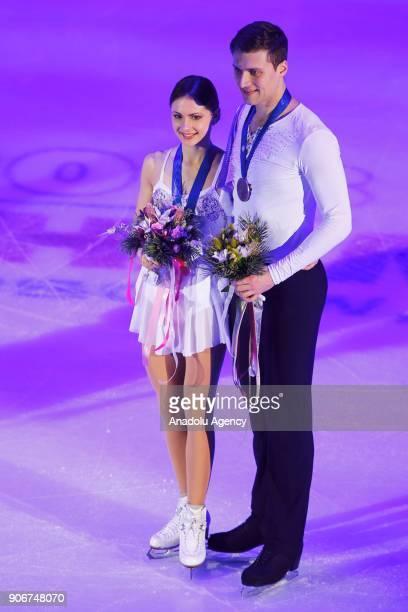 Bronze medalists Natalia Zabiiako and Alexander Enbert of Russia attend award ceremony of the Pairs eventof the ISU European Figure Skating...