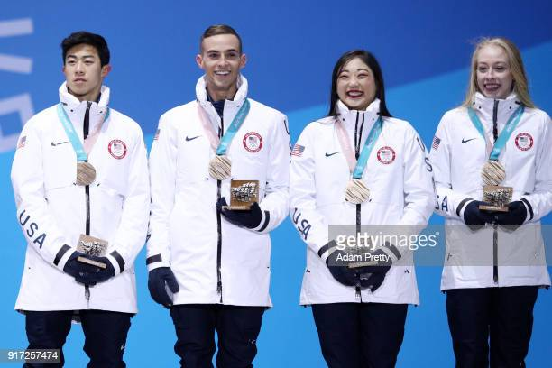 Bronze medalists Nathan Chen Adam Rippon Mirai Nagasu and Bradie Tennell of Team United States celebrate during the medal ceremony after the Figure...