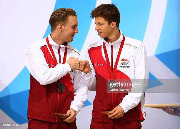 Bronze medalists Nick Robinson Baker and Freddie Woodward of England celebrate during the medal ceremony for the Men's Synchronised 3m Springboard...
