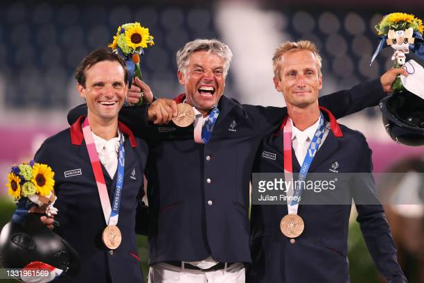 Bronze medalists Nicolas Touzaint, Karim Florent and Christopher Six of Team France pose with their bronze medals during the Eventing Jumping Team...