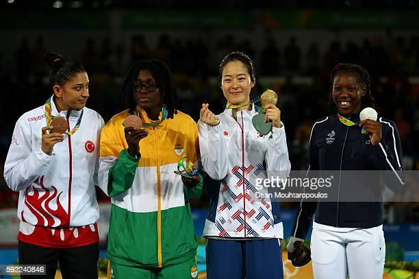 Bronze medalists Nur Tatar of Turkey and Ruth Gbagbi of Cote d'Ivoire gold medalist Hyeri Oh of South Korea and silver medalist Haby Niare of France...
