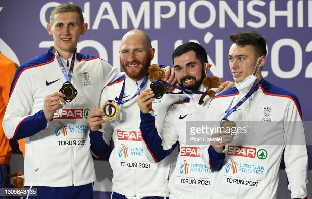 Bronze medalists of Team Great Britain pose for a photo during the medal ceremony for Men's 4 x 400 Metres Relay during the second session on Day 3...
