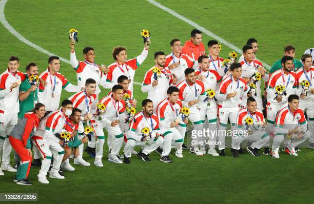 Bronze medalists of Team Mexico pose with their bronze medals during the Men's Football Competition Medal Ceremony on day fifteen of the Tokyo 2020...