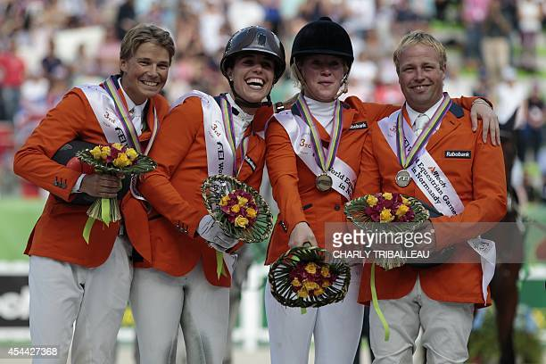 Bronze medalists of the team classification Netherland's Tim Lips Merel Blom Elaine Pen and Andrew Heffernan celebrate during the podium ceremony for...
