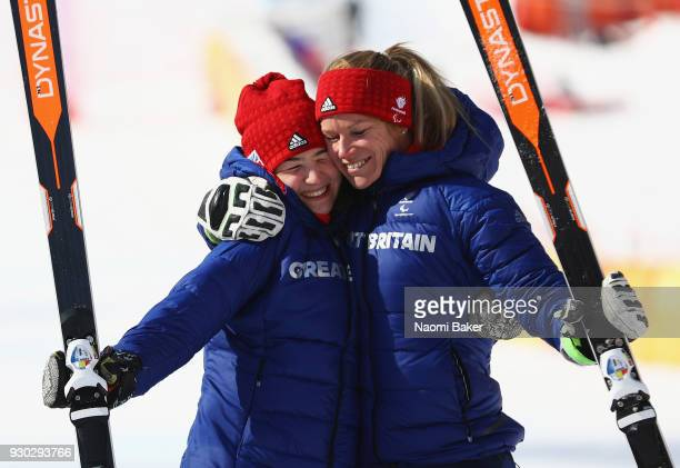 Bronze Medalists of the Women's Super G Visually Impaird Alpine Skiing Menna Fitzpatrick and her guide Jennifer Kehoe of Great Britain celebrate...