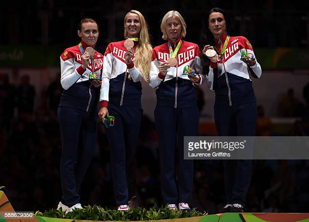 Bronze medalists Olga Kochneva Violetta Kolobova Tatiana Logunova and Lyubov Shutova of Russia stand on the podium during the medal ceremony for the...