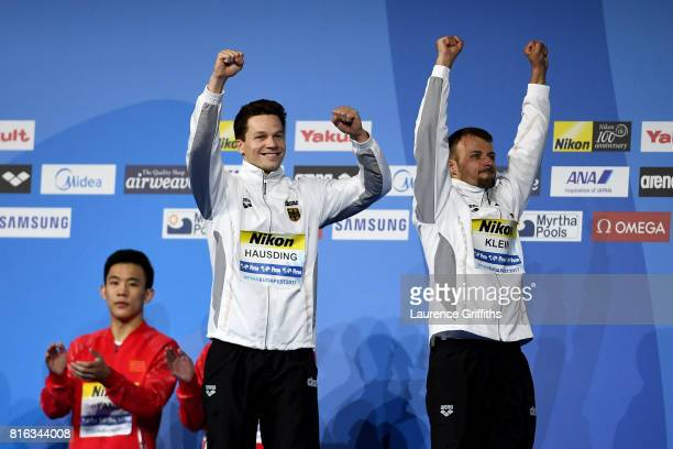 Bronze medalists Patrick Hausding and Sascha Klein of Germany celebrate during the medal ceremony for the Men's Diving 10M Synchro Platform final on...