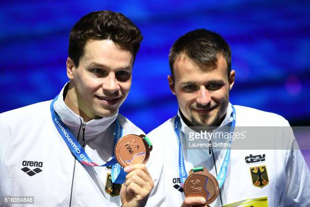 Bronze medalists Patrick Hausding and Sascha Klein of Germany pose with the medals won during the Men's Diving 10M Synchro Platform final on day four...