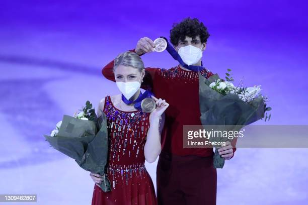 Bronze medalists Piper Gilles and Paul Poirier of Canada pose for a photo during the medal ceremony for Ice Dance Rhythm Dance and Ice Dance Free...
