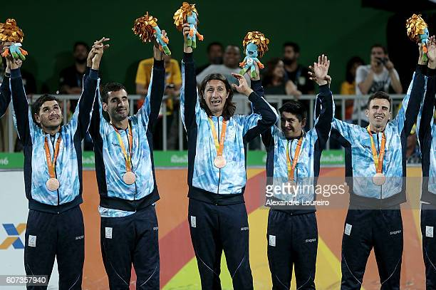 Bronze medalists players of Argentina celebrate on the podium at the medal ceremony for the Football 5aside Men's Gold Medal Match Brazil and Iran at...