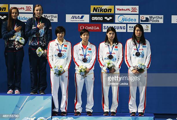 Bronze medalists Qiu Yuhan Shao Yiwen Zhang Yufei and Guo Junjun of China during the medal ceremony for the Women's 4x200m Freestyle Relay final on...