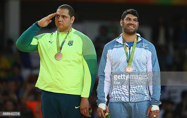 Bronze medalists Rafael Silva of Brazil and Or Sasson of Israel stand on the podium during the Men's 100kg Judo contest on Day 7 of the Rio 2016...