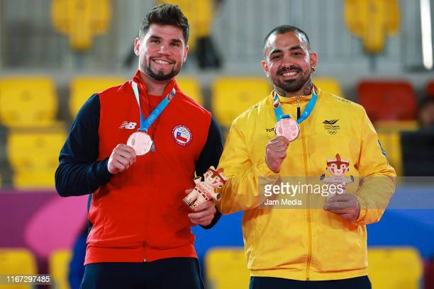 Bronze medalists Rodrigo Rojas of Canada and Diego Lenis of Colombia celebrate on the podium in the Karate Men's Over 84kg Final on Day 15 of Lima...