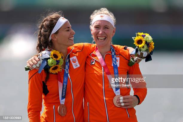 Bronze medalists Roos de Jong and Lisa Scheenaard of Team Netherlands pose with their medals during the medal ceremony for the Women's Double Sculls...