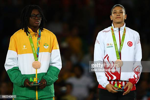 Bronze medalists Ruth Gbagbi of Cote d'Ivoire and Nur Tatar of Turkey pose on the podium during the medal ceremony for the Women's Taekwondo 67kg...