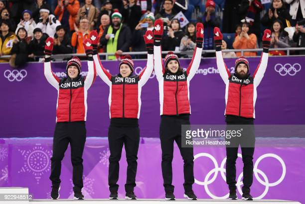 Bronze medalists Samuel Girard Charles Hamelin Charle Cournoyer and Pascal Dion of Canada celebrate during the victory ceremony after the Short Track...