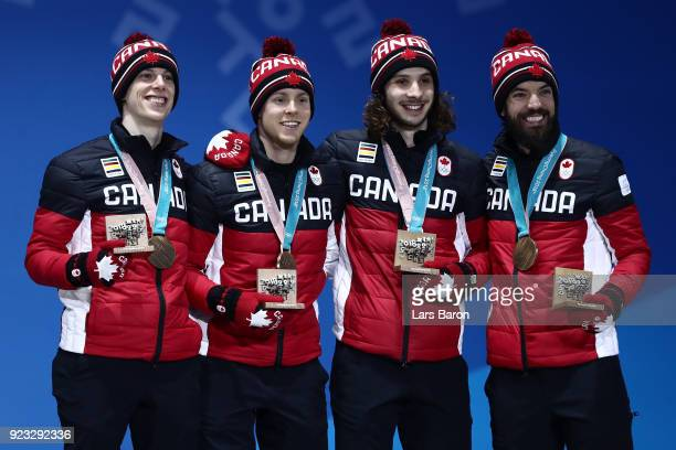 Bronze medalists Samuel Girard Charles Hamelin Charle Cournoyer and Pascal Dion of Canada celebrate during the medal ceremony for Short Track Speed...
