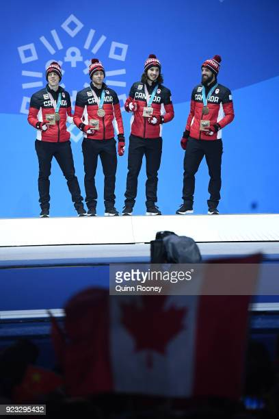 Bronze medalists Samuel Girard Charles Hamelin Charle Cournoyer and Pascal Dion of Canada stand on the podium during the medal ceremony for Short...