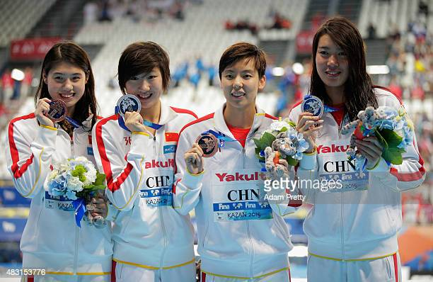 Bronze medalists Shao Yiwen Zhang Yufei Qiu Yuhan and Guo Junjun of China during the medal ceremony for the Women's 4x200m Freestyle Relay final on...