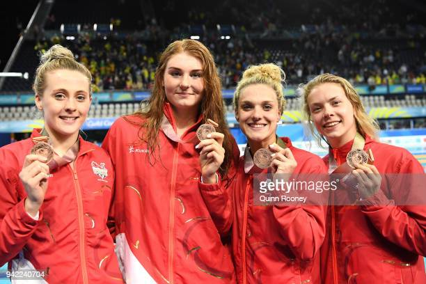 Bronze medalists Siobhan Marie O'connor Freya Anderson Anna Hopkin and Eleanor Faulkner of England pose during the medal ceremony for the Women's 4 x...