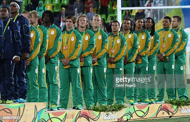 Bronze medalists South Africa stand on the podium during the medal ceremony for the Men's Rugby Sevens on Day 6 of the Rio 2016 Olympics at Deodoro...