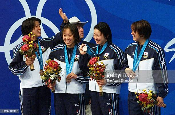 Bronze medalists Sumika Minamoto Junko Onishi Masami Tanaka and Mai Nakamura of Japan celebrate on the podium at the medal ceremony for the Women's...