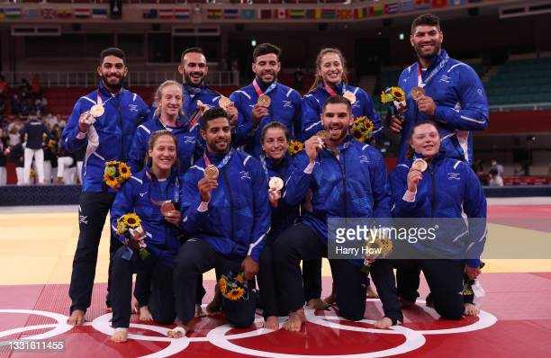 Bronze Medalists Team Israel pose with their bronze medals for Judo the Mixed Team Final on day eight of the Tokyo 2020 Olympic Games at Nippon...