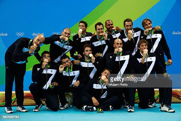 Bronze medalists Team Italy celebrate on the podium during the medal ceremony for the Men's Water Polo Gold Medal match between Croatia and Serbia on...