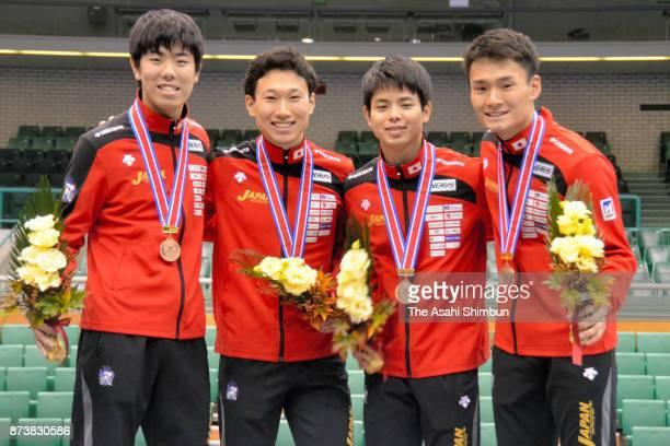 Bronze medalists Team Japan members Takahiro Shikine Toshiya Saito Ryohei Noguchi and Kosuke Matsuyama pose for photographs at the medal ceremony for...