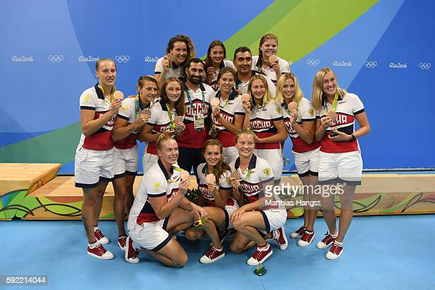 Bronze medalists Team Russia celebrate on the podium during the medal ceremony for the Women's Water Polo Gold Medal match between the United States...