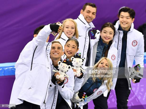 Bronze medalists Team United States pose for selfie photographs after the Figure Skating Team Event on day three of the PyeongChang 2018 Winter...