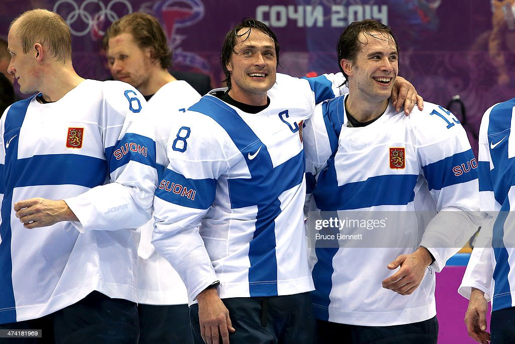 Bronze medalists Teemu Selanne #8 and Tuomo Ruutu #15 of Finland celebrate after defeating the United States 5-0 during the Men's Ice Hockey Bronze Medal Game on Day 15 of the 2014 Sochi Winter Olympics at Bolshoy Ice Dome on February 22, 2014 in Sochi, Russia.