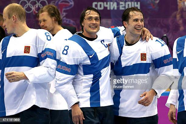 Bronze medalists Teemu Selanne and Tuomo Ruutu of Finland celebrate after defeating the United States 5-0 during the Men's Ice Hockey Bronze Medal...