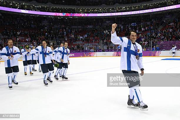 Bronze medalists Teemu Selanne of Finland and teammates celebrate after defeating the United States 5-0 during the Men's Ice Hockey Bronze Medal Game...