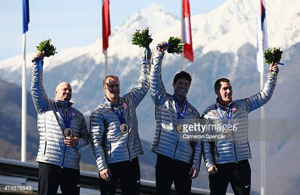 Bronze medalists the United States team 1 celebrate on the podium during the medal ceremony for the FourMan Bobsleigh on Day 16 of the Sochi 2014...