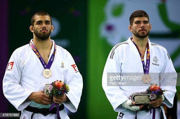 Bronze medalists Toma Nikiforov of Belgium and Cyrille Maret of France stand on the podium during the medal ceremony for the Men's Judo 100kg during...