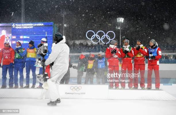 Bronze medalists Wilhelm Denifl of Austria Lukas Klapfer of Austria Bernhard Gruber of Austria Mario Seidl of Austria pose during the victory...