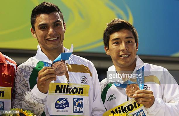 Bronze medalists Yahel Castillo and Julian Sanchez of Mexico pose for a photo with their medals following the medal cermony for the Men's 3m...