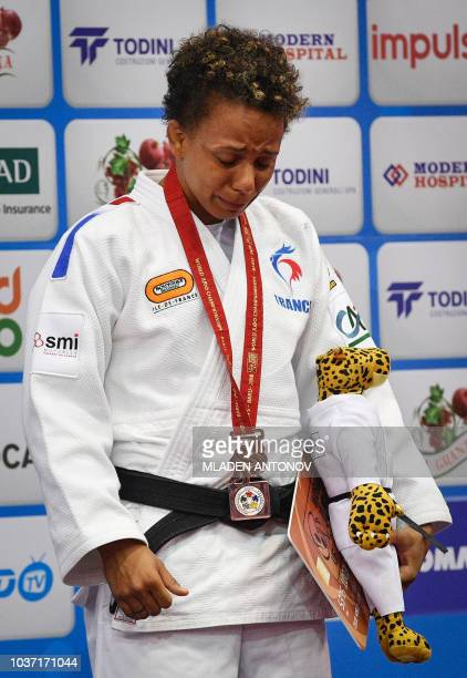 Bronze medallist Amandine Buchard of France cries during the medal ceremony for the under 52kg women category of the 2018 Judo World Championships in...
