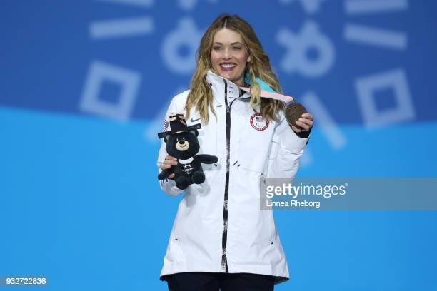 Bronze medallist Amy Purdy of USA celebrates during the medal ceremony for the Women's Snowboard Banked Slalom SBLL1 Final on day seven of the...