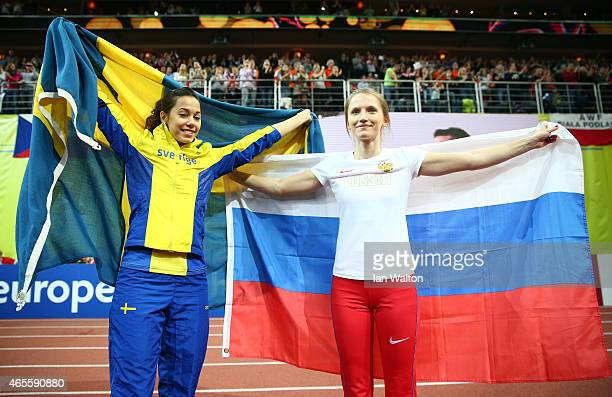 bronze medallist Angelica Bengtsson of Sweden and gold medallist Anzhelika Sidorova of Russia after the Women's Pole Vault Final during day three of...
