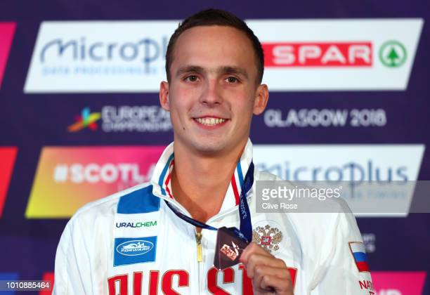 Bronze medallist Anton Chupkov of Russia poses during the medal ceremony for the Men's 100m Breaststroke Swimming Final on Day three of the European...