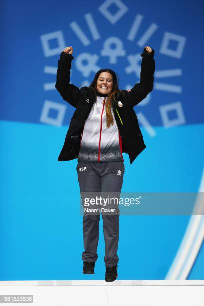 Bronze medallist Astrid Fina Paredes of Spain poses during the medal ceremony for the Women's Snowboard Cross SBLL2during day four of the PyeongChang...