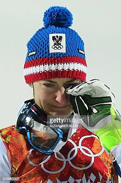 Bronze medallist Austria's Kathrin Zettel sheds a tear on the podium during the Women's Alpine Skiing Slalom Flower Ceremony at the Rosa Khutor...